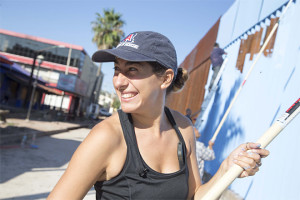 Artist Ana Teresa Fernández paints the border fence that splits up Mexico and the U.S., Tuesday, Oct. 13, 2015, in Nogales, Mexico. Fernández, who was born in Mexico but raised in San Diego, is leading an effort to paint the border fence in Nogales, Sonora, so blue that it blends with the sky, rendering it nearly invisible. Nogales sits on the border with Nogales, Arizona. (Nick Oza/The Arizona Republic via AP) MARICOPA COUNTY OUT; MAGS OUT; NO SALES; MANDATORY CREDIT